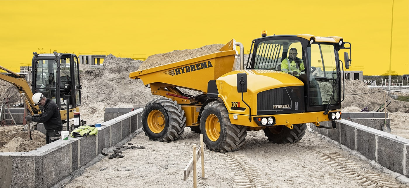 Hydrema 912FS compact dump truck driving alongside harbour